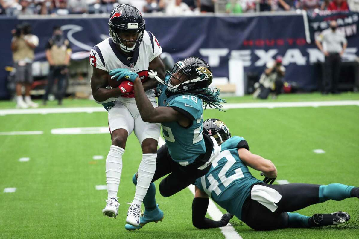 Brandin Cooks hauled in a pair of long passes, including this 52-yard catch, to set up Texans touchdowns during the first half of Sunday's season-opening win over the Jaguars.