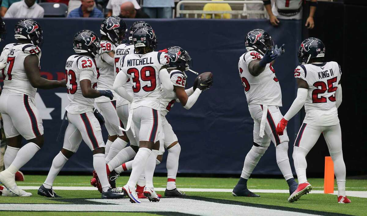 Houston Texans players celebrate cornerback Vernon Hargreaves III's (26) turnover during the first half of an NFL football game against the Jacksonville Jaguars Sunday, Sept. 12, 2021, in Houston.