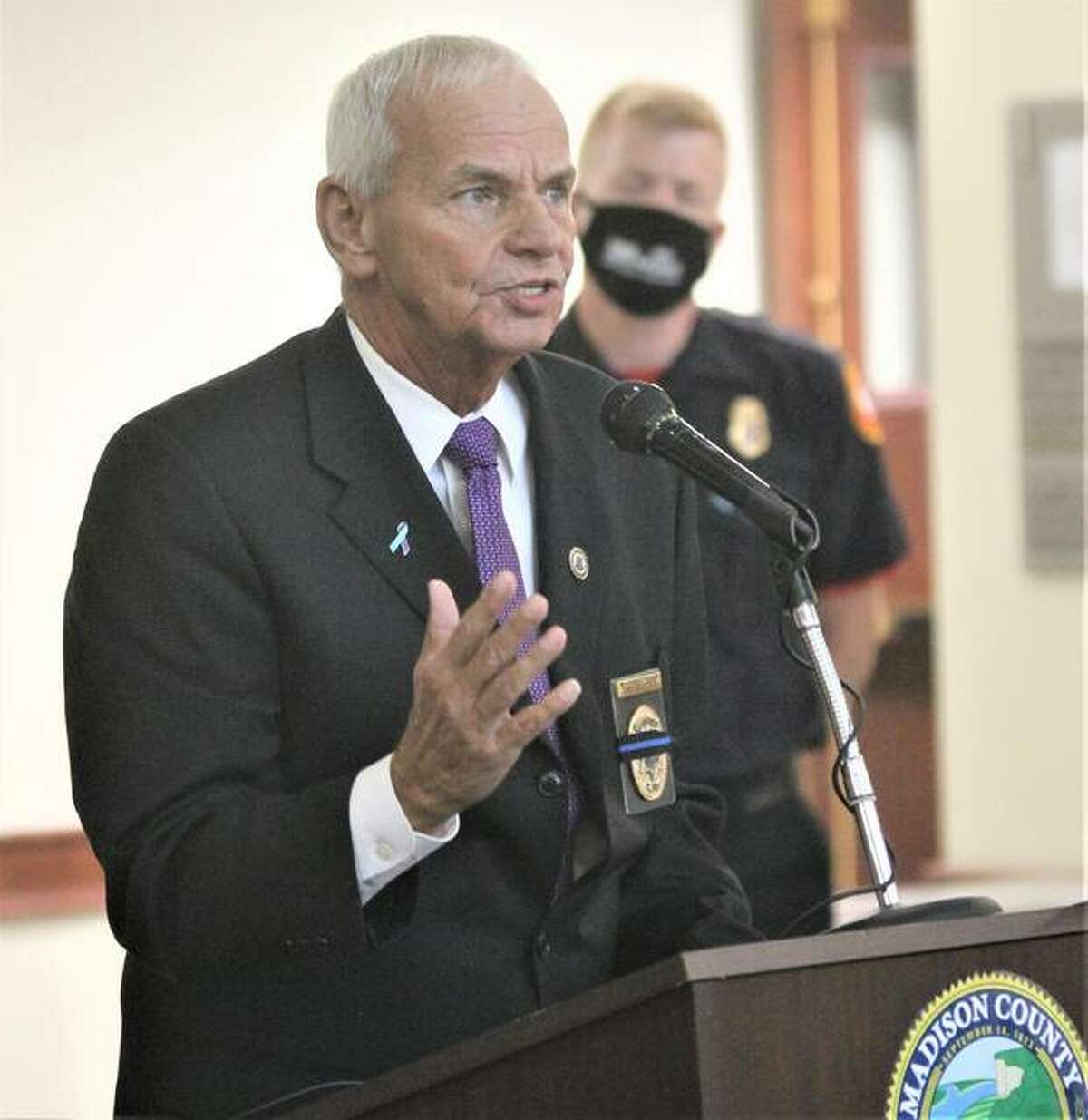Madison County Coroner Steve Nonn speaks at a National Suicide Prevention Awareness Prevention Month event Friday in the Madison County Administration Building in Edwardsville.