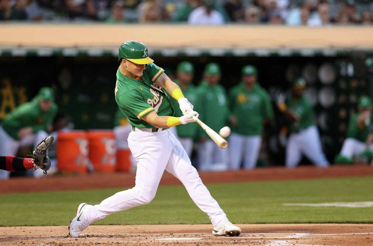 OAKLAND, CALIFORNIA - SEPTEMBER 08: Matt Chapman #26 of the Oakland Athletics hits a home run in the second inning against the Chicago White Sox at RingCentral Coliseum on September 08, 2021 in Oakland, California. (Photo by Ezra Shaw/Getty Images)