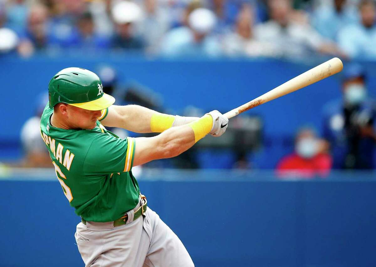 TORONTO, ON - SEPTEMBER 04: Matt Chapman #26 of the Oakland Athletics hits a home run in the fifth inning during a MLB game against the Toronto Blue Jays at Rogers Centre on September 4, 2021 in Toronto, Ontario, Canada. (Photo by Vaughn Ridley/Getty Images)