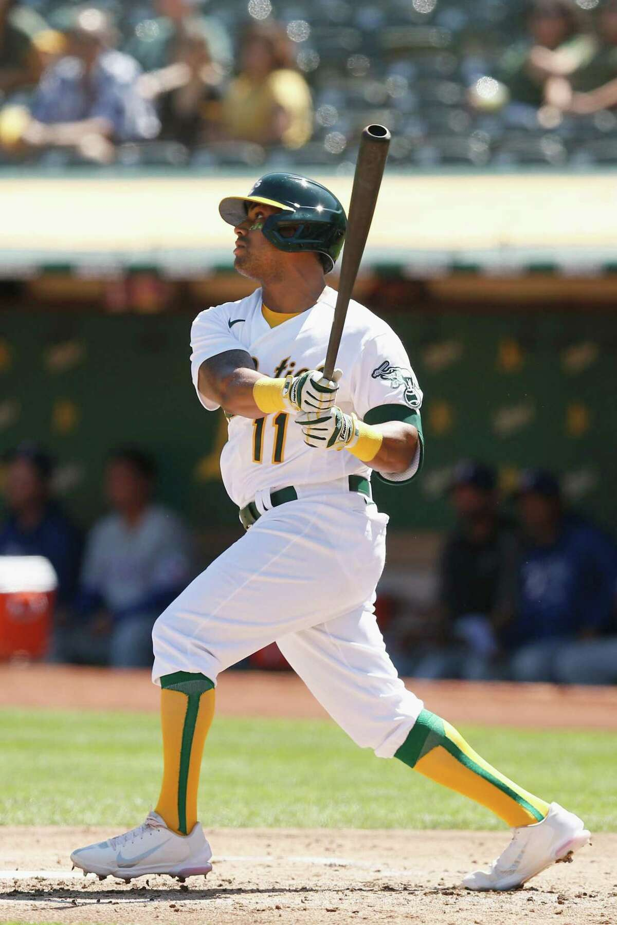 OAKLAND, CALIFORNIA - SEPTEMBER 11: Khris Davis #11 of the Oakland Athletics hits a double in the bottom of the second inning against the Texas Rangers at RingCentral Coliseum on September 11, 2021 in Oakland, California. (Photo by Lachlan Cunningham/Getty Images)