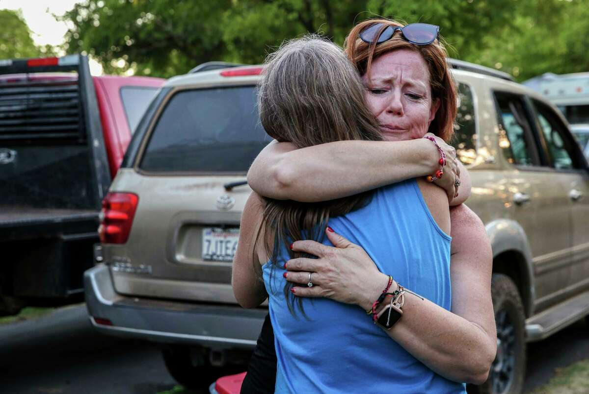 Jennifer McKim-Hibbard embraces Karen Hicks at 49er Village RV Resort in Plymouth (Amador County). McKim-Hibbard and her family were forced to evacuate their home in Grizzly Flats when the flames from the Caldor Fire ripped through the area.