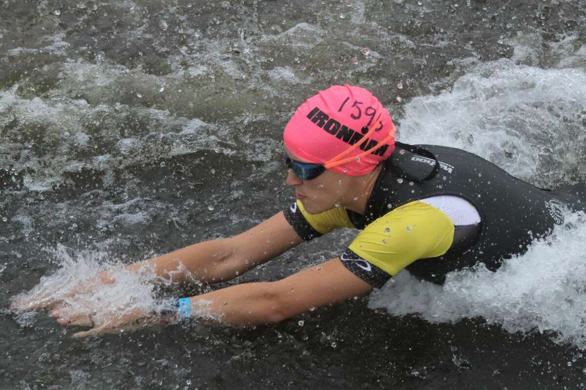 Racers get underway during the swimming portion of the triathlon during theIRONMAN 70.3 Michigan on Sept. 12 at Frankfort.