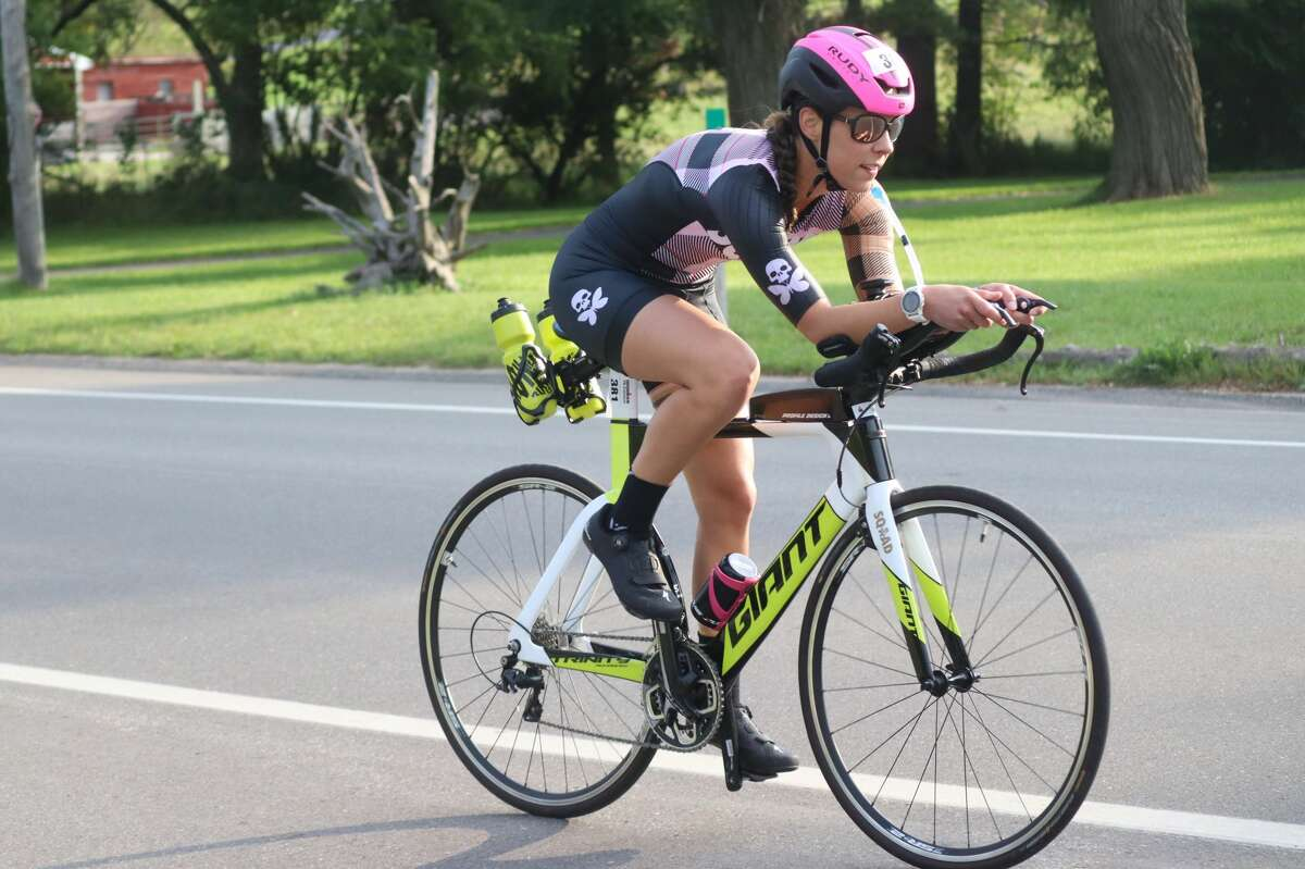 Racers compete in the biking portion of the IRONMAN 70.3 Michigan on Sept. 12.