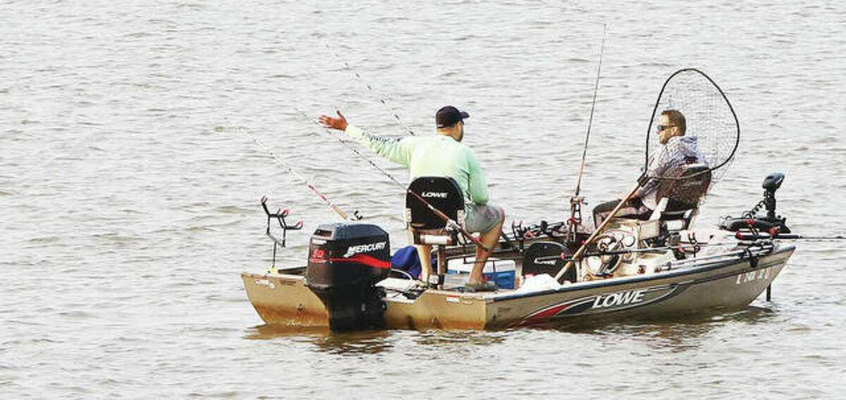 Two fishermen participating in the Alton Catfish Classic were on the Mississippi River in Godfrey early Saturday morning. One hundred teams landed and released 177 fish Saturday with a combined weight of 3,156.07 pounds.