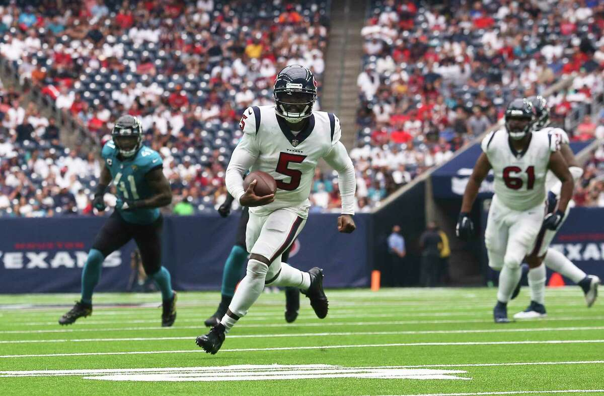 Texans quarterback Tyrod Taylor (5) scrambles out of the pocket in an opening win over the Jaguars.