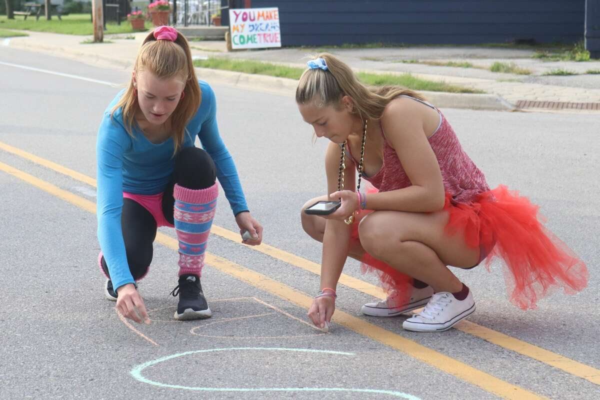 Benzie Central's cross country team volunteered to manage a water station along the running course, which featured 1980's outfits and music as well as fun signs and chalk art on the road.