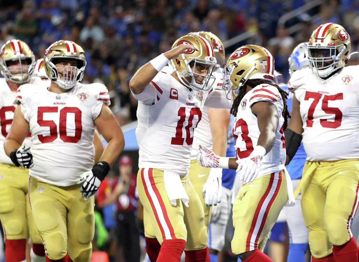 Quarterback Jimmy Garoppolo congratulates JaMycal Hasty after the running back's 3-yard touchdown run late in the second quarter gave the 49ers a 21-10 lead.