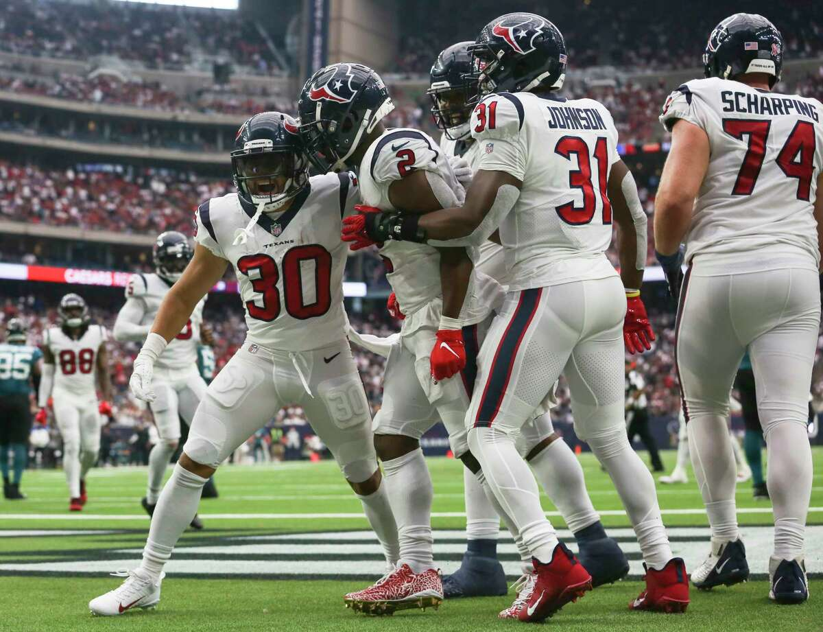 Houston Texans players celebrate running back Phillip Lindsay's (30) touchdown during the second half of an NFL football game against the Jacksonville Jaguars Sunday, Sept. 12, 2021, in Houston.