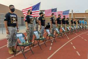 Students from Cigarroa, Martin and Nixon High Schools who participate in JROTC pay tribute to Lance Corporal David Lee Espinoza at Shirley Field on Friday, Sept. 10, 2021 prior to a football game between Cigarroa and LBJ.