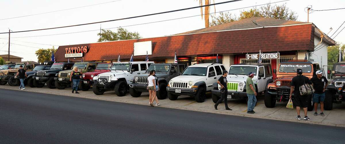 The Misfits 4x4 Jeep club gather outside of Wizard Wicks to support the Musicians for Marines Tribute to Lance Corporal David Lee Espinoza event, Saturday, Sept. 11, 2021. The event raised funds for Espinoza's family.