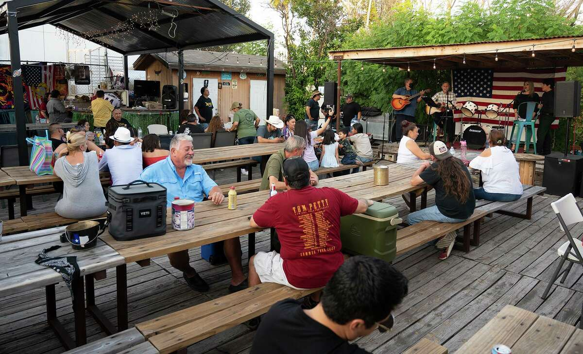 """Musicians gather at Wizard Wicks for the """"Musicians for Marines"""" tribute to Lance Corporal David Lee Espinoza on Saturday, Sept. 11, 2021. A plate sale and live music helped raise funds for Espinoza's family."""