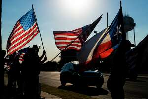 Laredoans gather to wave flags in remembrance of 9/11 on Saturday, Sept. 11, 2021 on Del Mar Boulevard.