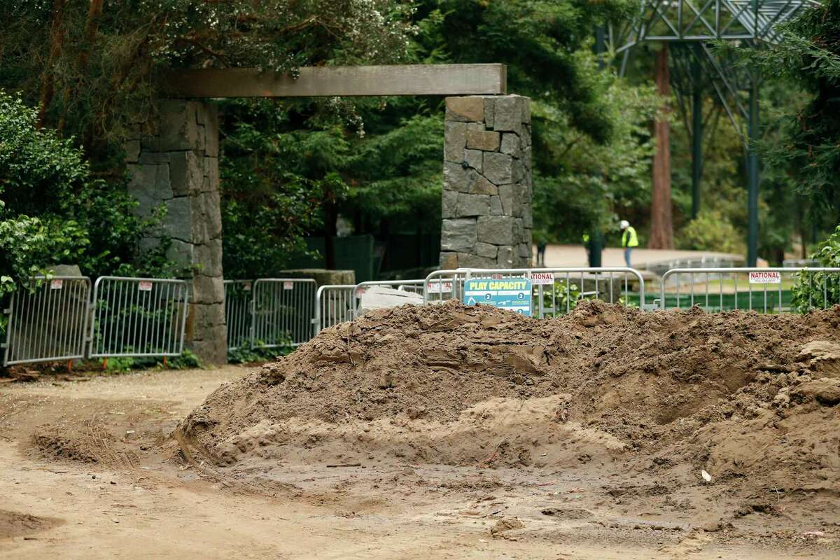 A wall of mud testifies to extensive damage after a water pipe break caused a massive flood at Stern Grove in San Francisco. Crews are hauling out mud and toppled trees in hopes of having the annual Stern Grove concert festival proceed as normal next summer.