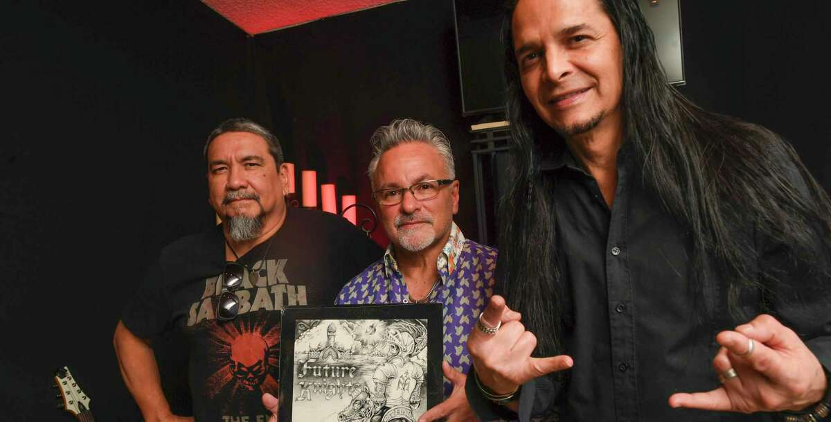"""Members of the former San Antonio metal band Wyzard, John Alvarado (from left), Michael Valenzuela and Buster Grant, display their rare 1984 EP """"Future Knights,"""" which now sells for a few thousand dollars a copy."""