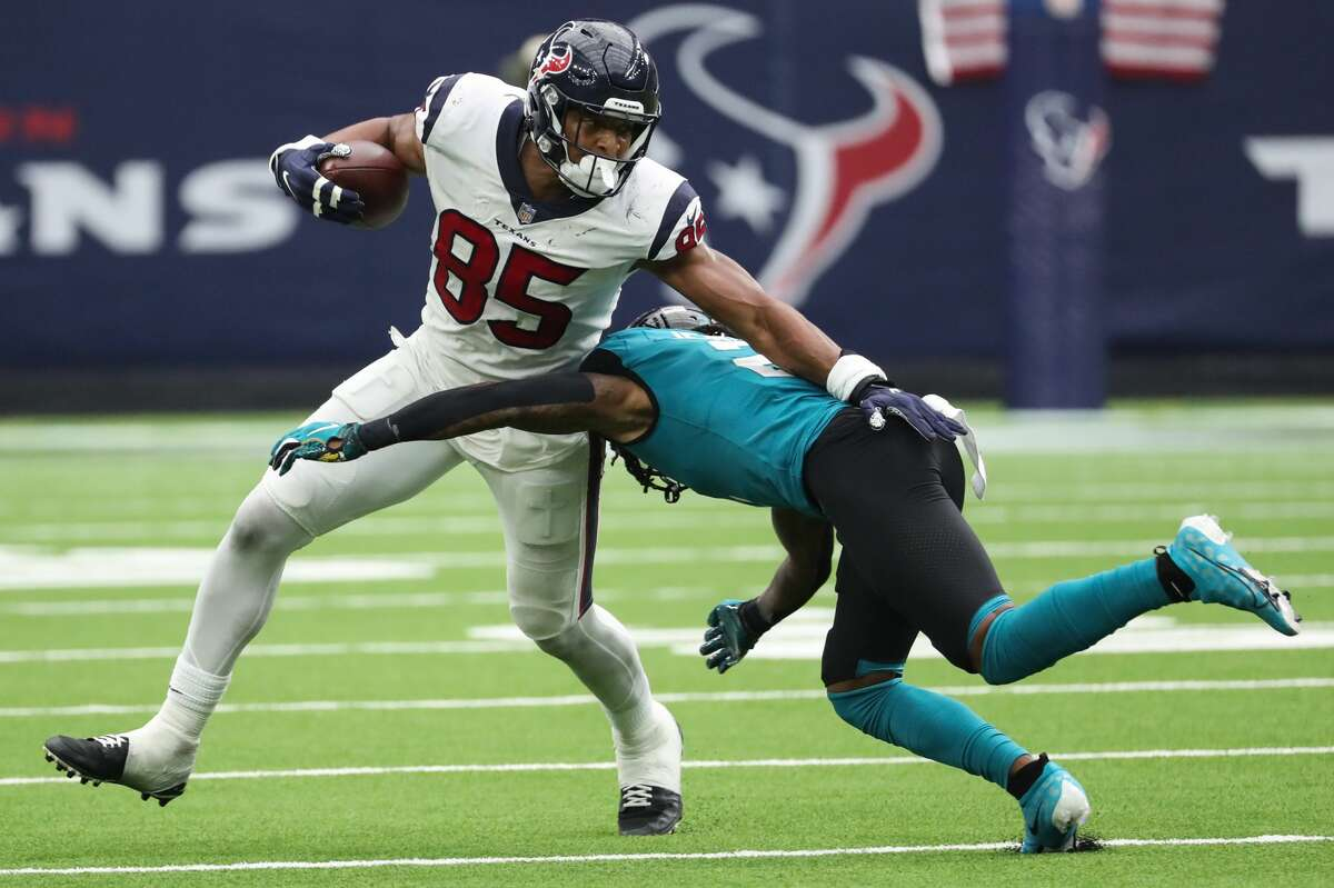 Houston Texans tight end Pharaoh Brown (85) is hit by Jacksonville Jaguars safety Rayshawn Jenkins (2) as he makes a reception during the third quarter of an NFL football game Sunday, Sept. 12, 2021, in Houston.