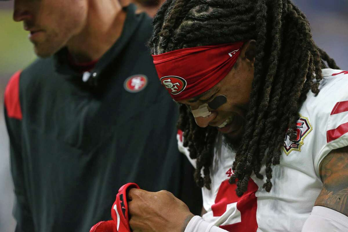 49ers defensive back Jason Verrett leaves the field after injuring his left knee in the second half against the Lions.
