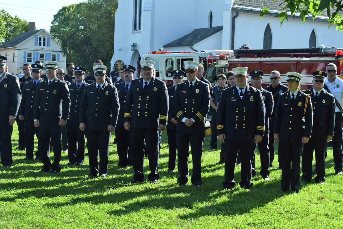 Branford Fire personnel in formation at the service Saturday on the Branford Green.