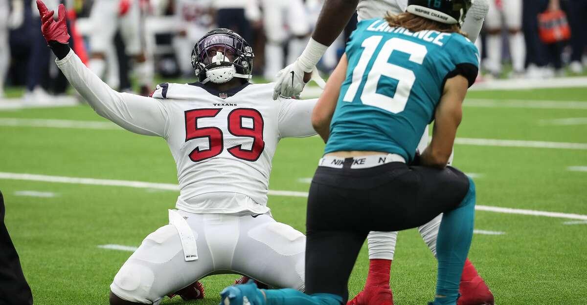 Houston Texans defensive end Whitney Mercilus (59) celebrates after recording a sack of Jacksonville Jaguars quarterback Trevor Lawrence (16) during the fourth quarter of an NFL football game Sunday, Sept. 12, 2021, in Houston.