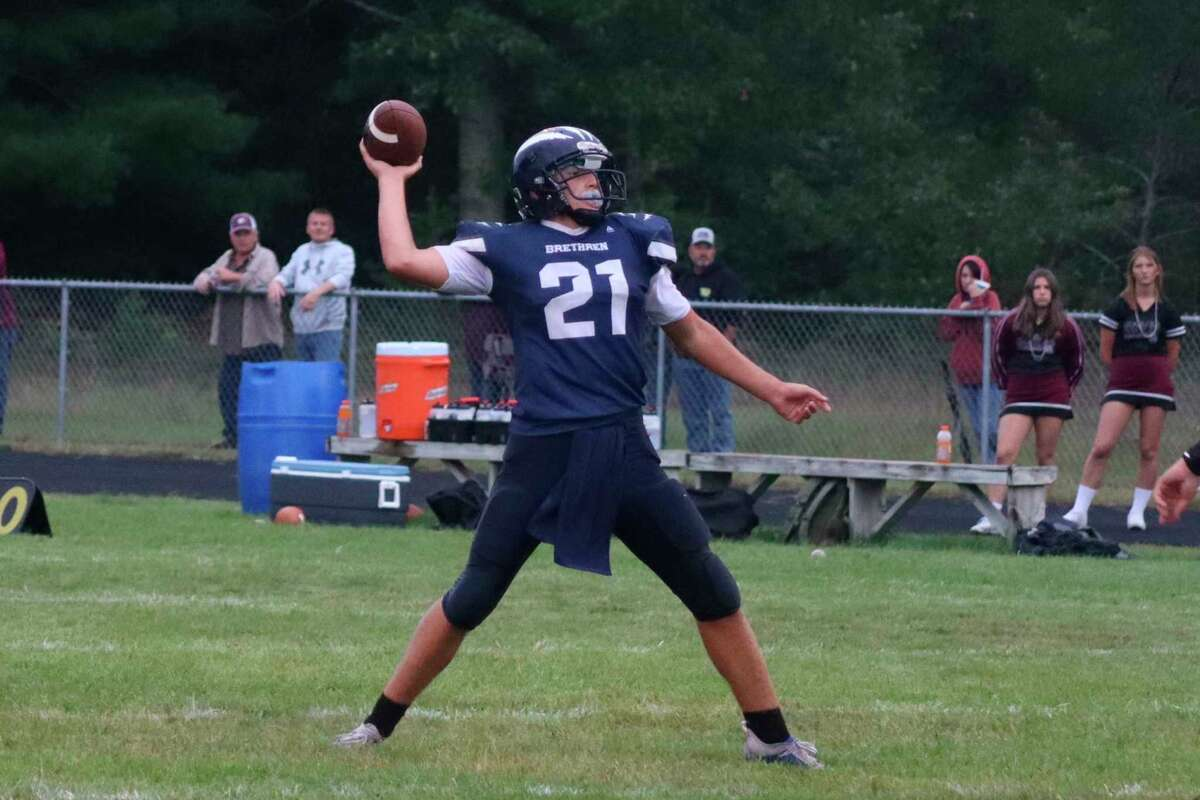 Brethren quarterback Clayton Mobley looks to pass the ball downfield during a game earlier this year. (File photo)