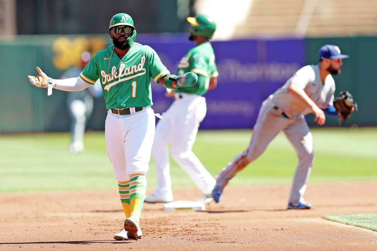Oakland Athletics' Josh Harrison gestures after an inning-ending double play in 1st inning against Texas Rangers during MLB game at Oakland Coliseum in Oakland, Calif., on Sunday, September 12, 2021.