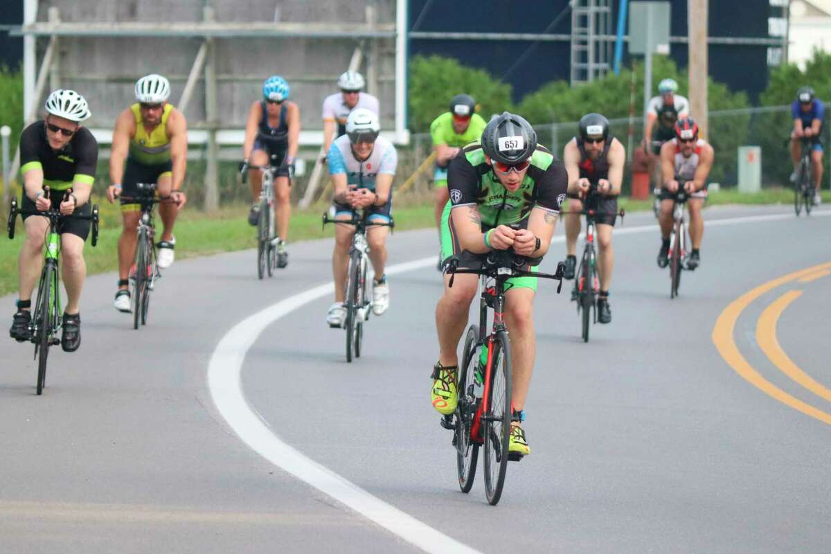 Cyclists roll down on M-22 during the second leg of Sunday's IRONMAN 70.3 Michigan on Sunday. (Robert Myers/News Advocate)