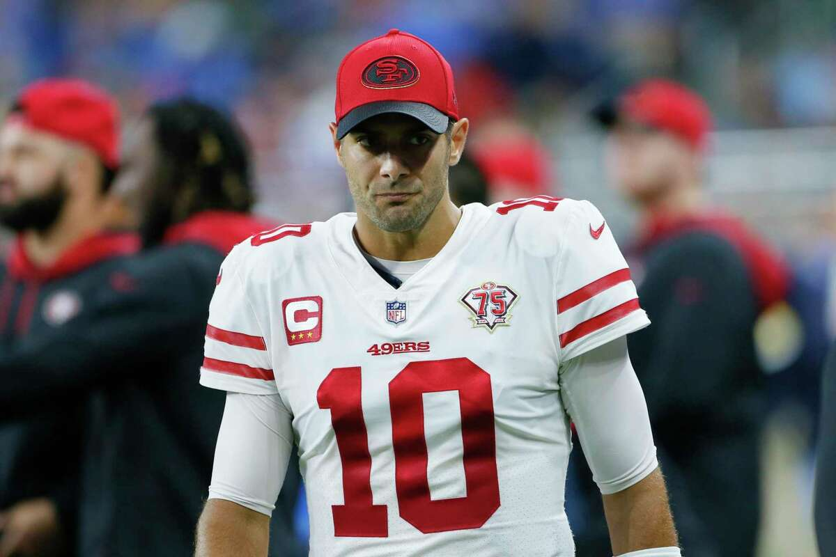 San Francisco 49ers quarterback Jimmy Garoppolo watches from the sidelines against the Detroit Lions in the first half of an NFL football game in Detroit, Sunday, Sept. 12, 2021. (AP Photo/Duane Burleson)