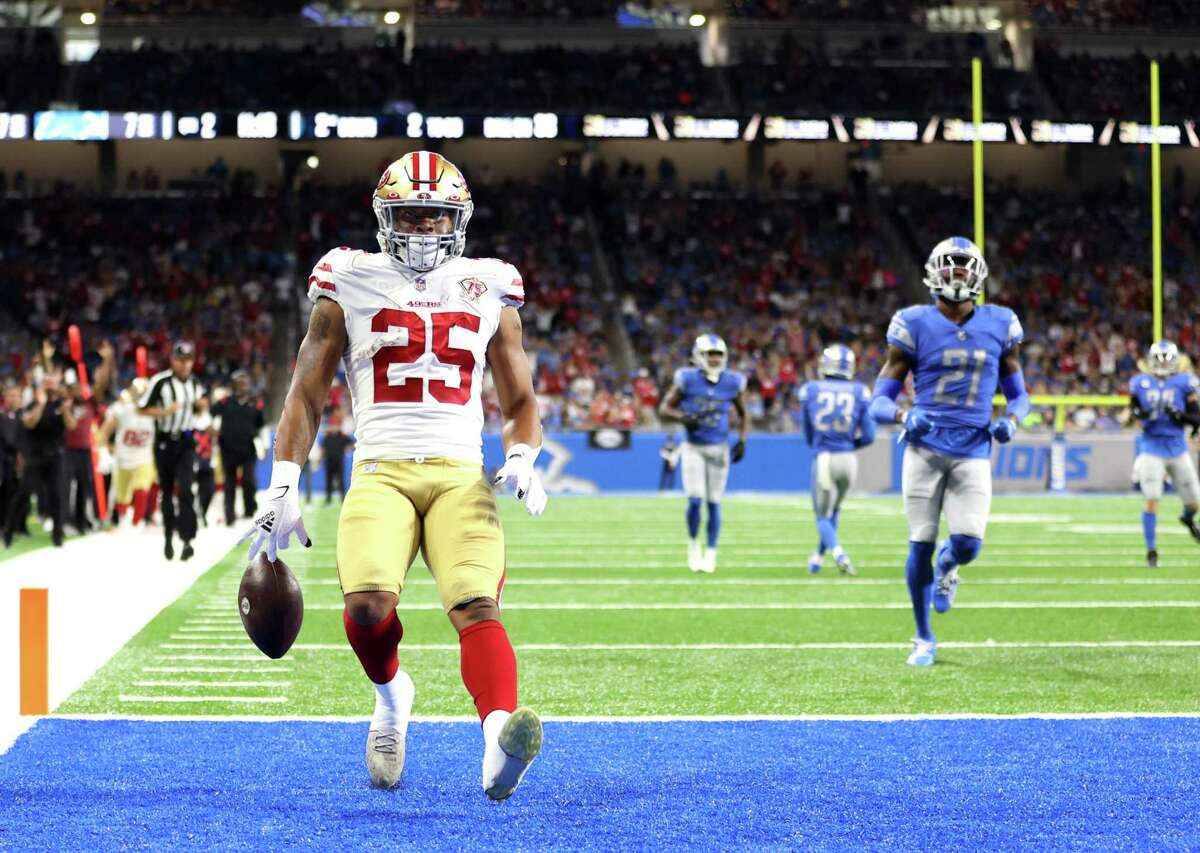 Elijah Mitchell arrives in the end zone after his 38-yard run in the second quarter, giving the 49ers a 14-7 lead over the Lions.