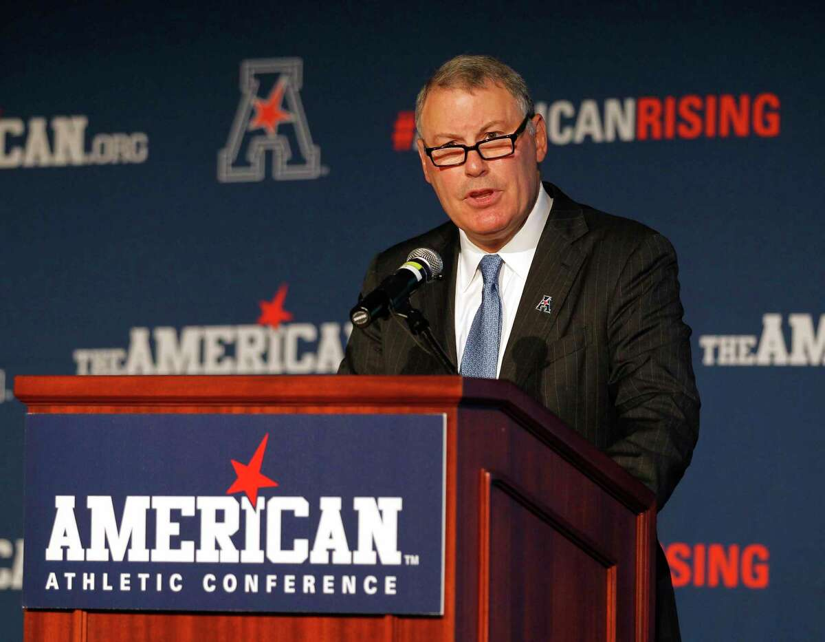 In this Aug. 4, 2015 file photo, American Athletic Conference Commissioner Mike Aresco addresses the media during an NCAA football media day in Newport, R.I.
