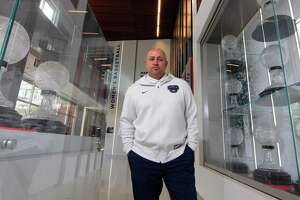 UConn Athletic Director David Benedict poses inside the Worth Family UConn Basketball Center's Maiden Hall of Champions on the campus in Storrs, Conn., on Thursday Mar. 4, 2021.