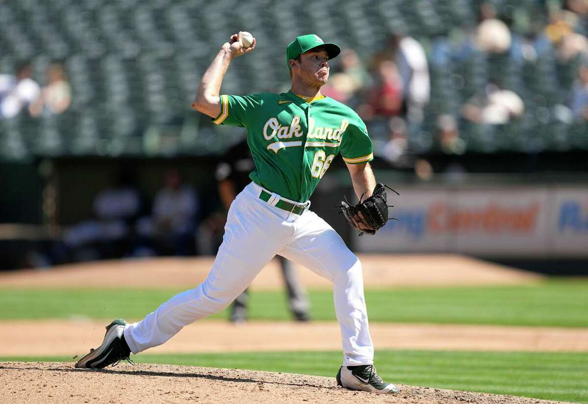 OAKLAND, CALIFORNIA - SEPTEMBER 12: Daulton Jefferies #66 of the Oakland Athletics pitches against the Texas Rangers in the top of the fourth inning at RingCentral Coliseum on September 12, 2021 in Oakland, California. (Photo by Thearon W. Henderson/Getty Images)