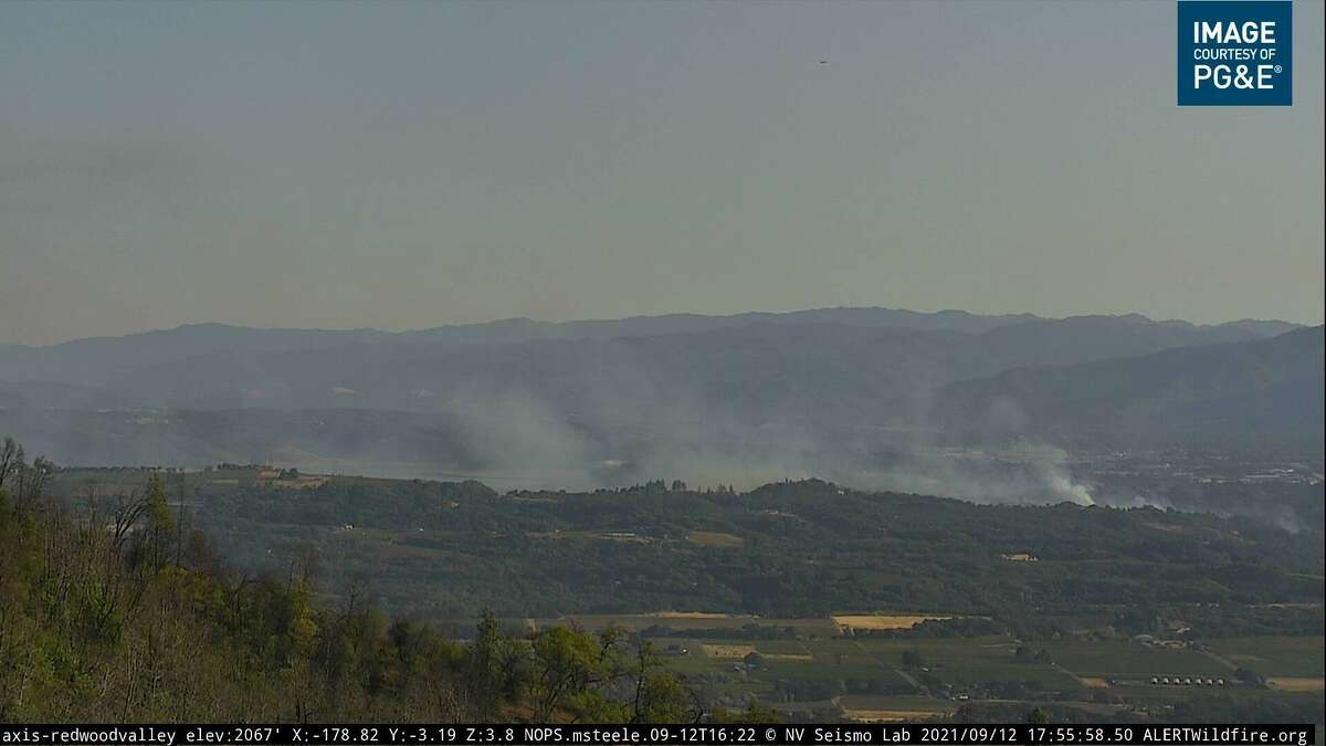 Smoke billows from the site of the Hopkins Fire near Calpella in Mendocino County. This photo was captured by a Pacific Gas and Electric Co. camera in Redwood Valley.