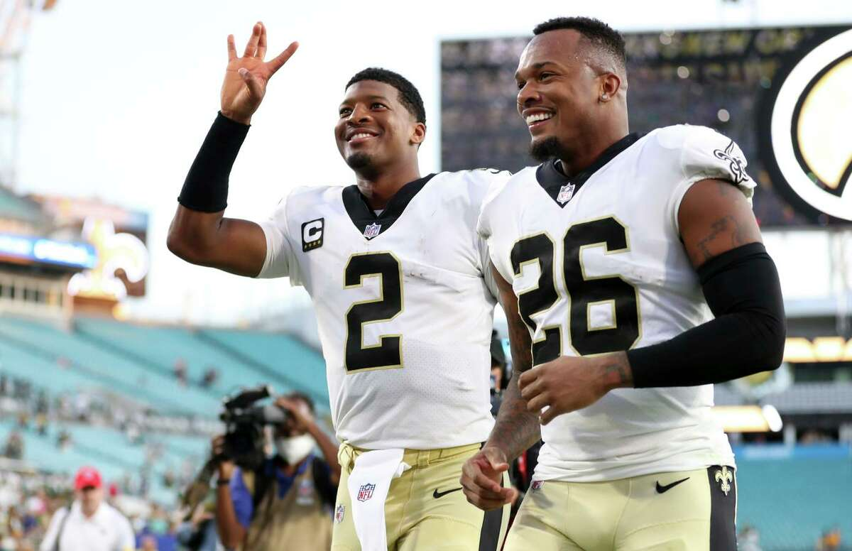 Jameis Winston (2) and P.J. Williams of the Saints react after defeating the Packers. Wilson threw for five tuchdowns, and his team intercepted reigning NFL MVP Aaron Rodgers twice.
