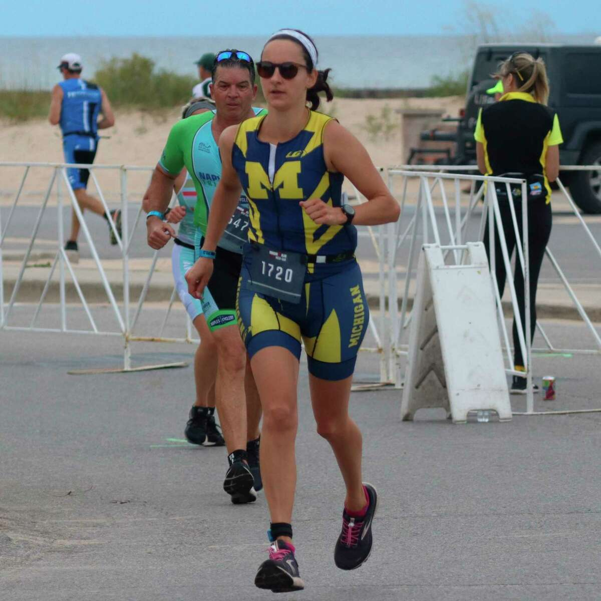 Runners finished their triathlon at Frankfort Beach on Sept. 12. (Robert Myers/Record Patriot)