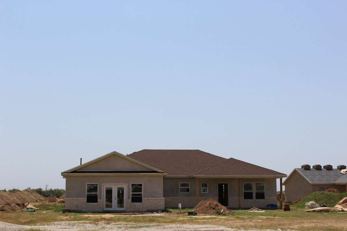 Strawberry Fields offers seven floor plans. Standard features include a covered front and back porch, vinyl windows, all-wood cabinets and granite on all the countertops.