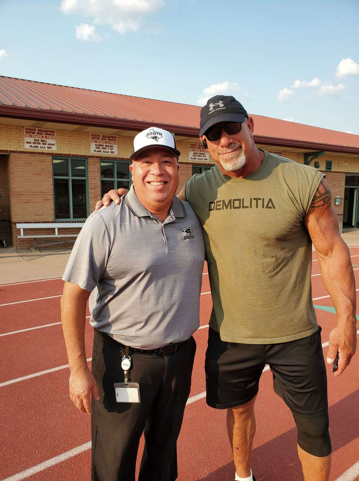 UISD athletic director Bobby Cruz is pictured with WWE star Bill Goldberg at the SAC on Friday prior to a game between United South and Boerne Champion.