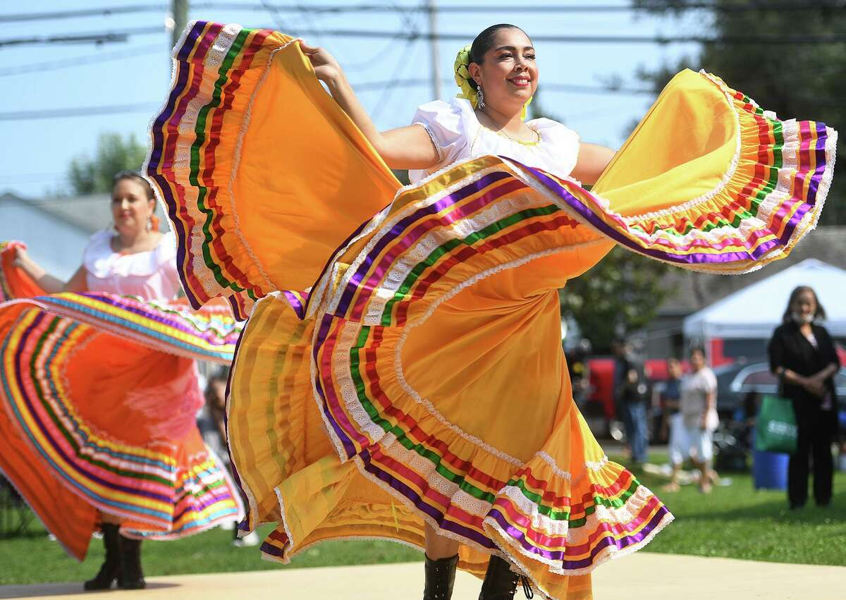 Dancers Julie Rodriguez, left, and Leticia Riesta, both of Wallingford, perform with the Mexican mariachi group Margarito Mariachi at the Stratford Latin Music Festival on Paradise Green in Stratford, Conn. on Sunday, September 12, 2021.