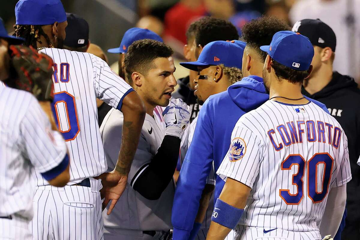 The Yankees' Gleyber Torres and the Mets' Francisco Lindor exchange word as both teamss benches clear after Giancarlo Stanton hit a two-run home run in the seventh inning of a game at Citi Field on September 12, 2021 in New York City.