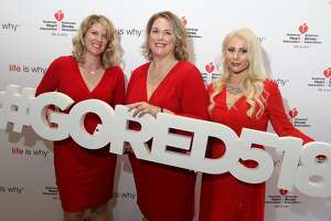 Former B95.5 radio personality Meredith McNeil (l) and former FLY 92.3 radio personality Christy Whitaker (r) pose with Better U member Emelene Bennett(center) in the American Heart Association photo booth during the 14th Annual Go Red for Women luncheon.   McNeil announced she is no longer with the Breakfast Club.