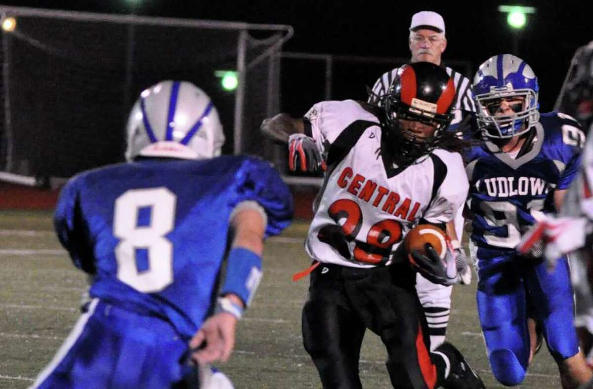 Bridgeport Central's Davin Campbell weaves in and out of Fairfield Ludlowe's defensemen Matt Fallon (8) and Mike Nagy (91) during the first quarter of Thursday's season opener football game against Fairfield Ludlowe at Ludlowe on Thursday, Sept. 16, 2010.