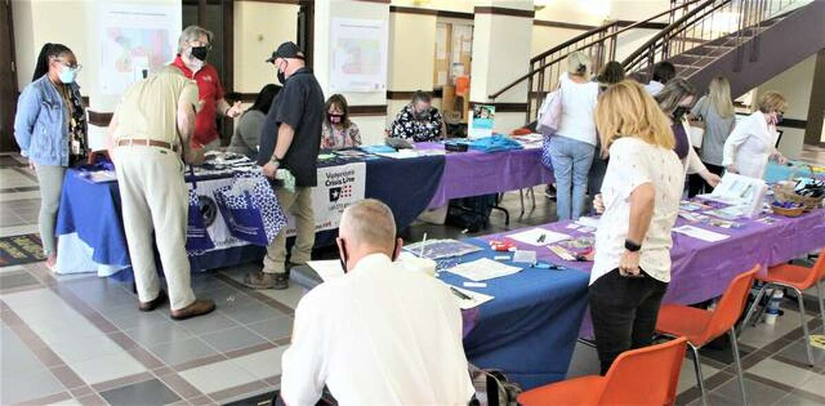 Vendors hand out information and gifts in the lobby of the Madison County Administration Building Friday afternoon at a county-sponsored National Suicide Prevention Awareness Prevention Month event at the Madison County Administration Building on World Suicide Prevention Day Sept. 10.