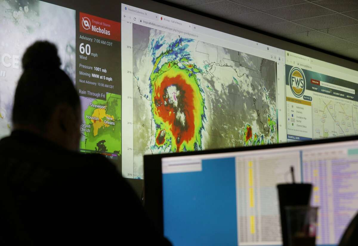 A Houston Police Department employee works at the city's emergency operations center as Tropical Storm Nicholas moves towards the Texas coast Monday, Sept. 13, 2021, in Houston.