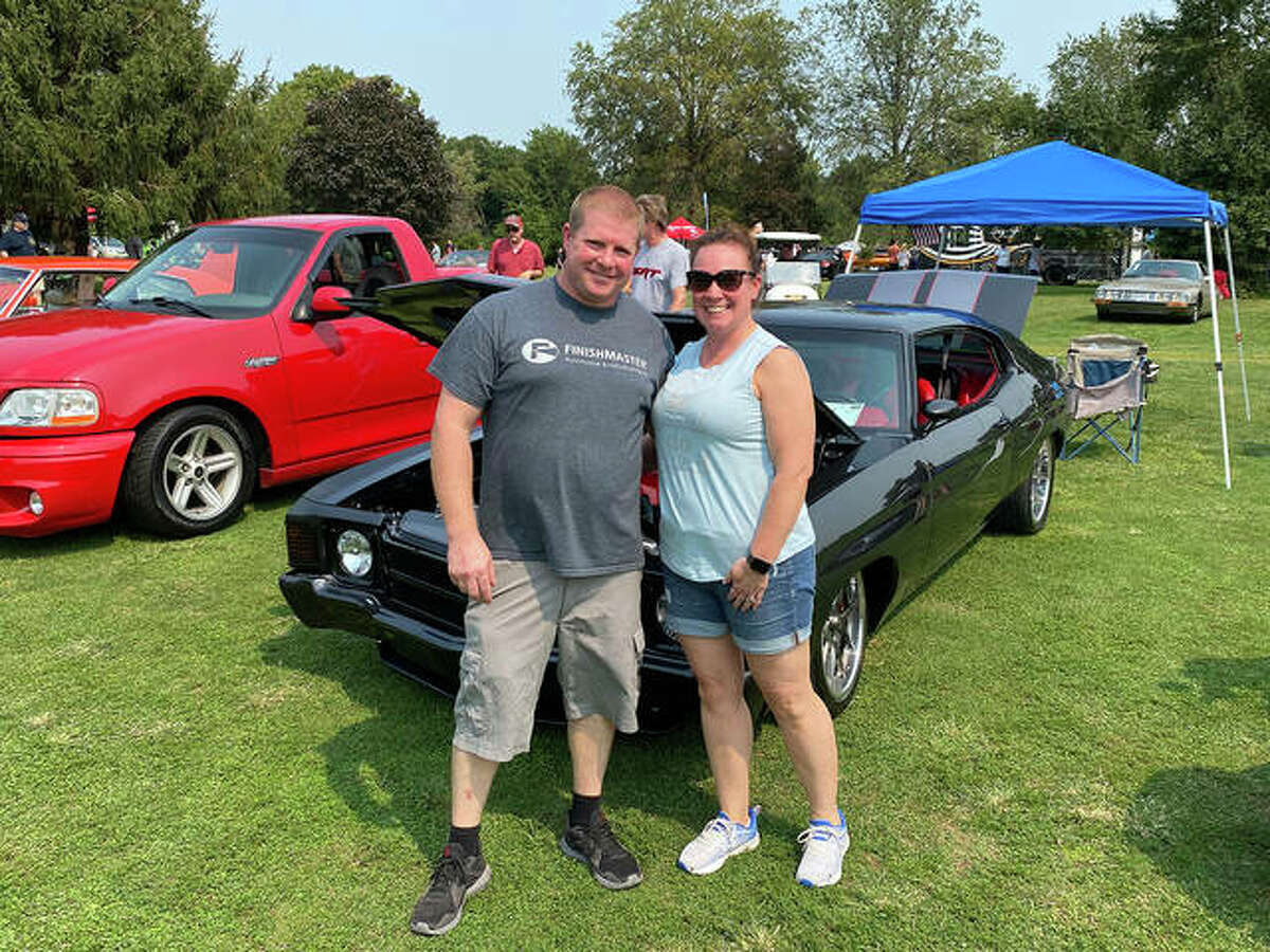 Paul and Amie Raymond from Jerseyville stand in from of their Chevrolet Chevelle Saturday. One of four mid-size cars from General Motors, the so-called A-bodies from the late 60s and early 70s are among the quintessential muscle cars.