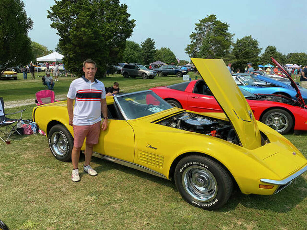 """Kicks on 66 attracts a lot of enthusiasts from all four directions. Tom Northcott from St. Louis stands in front of his early 70s Corvette Convertible, complete with Chevy's 454 CID (7.4-liter) """"Rat"""" V-8 engine. Like all Corvettes between 1954 and mid-1981, Northcott's car was made in GM's St. Louis factory. Nineteen seventy-two was the final year for the car's front and rear chrome bumpers."""