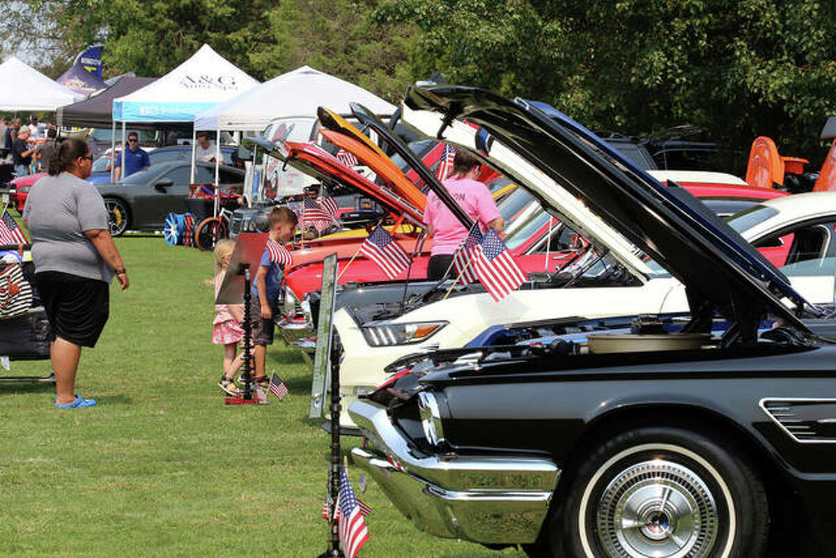 The Kicks on Route 66 Ultra Car Show and Cruise was a hit for all ages on Saturday at Post 199 in Edwardsville. In the foreground is a mid-60s Ford Thunderbird while behind it is a modern Ford Mustang.