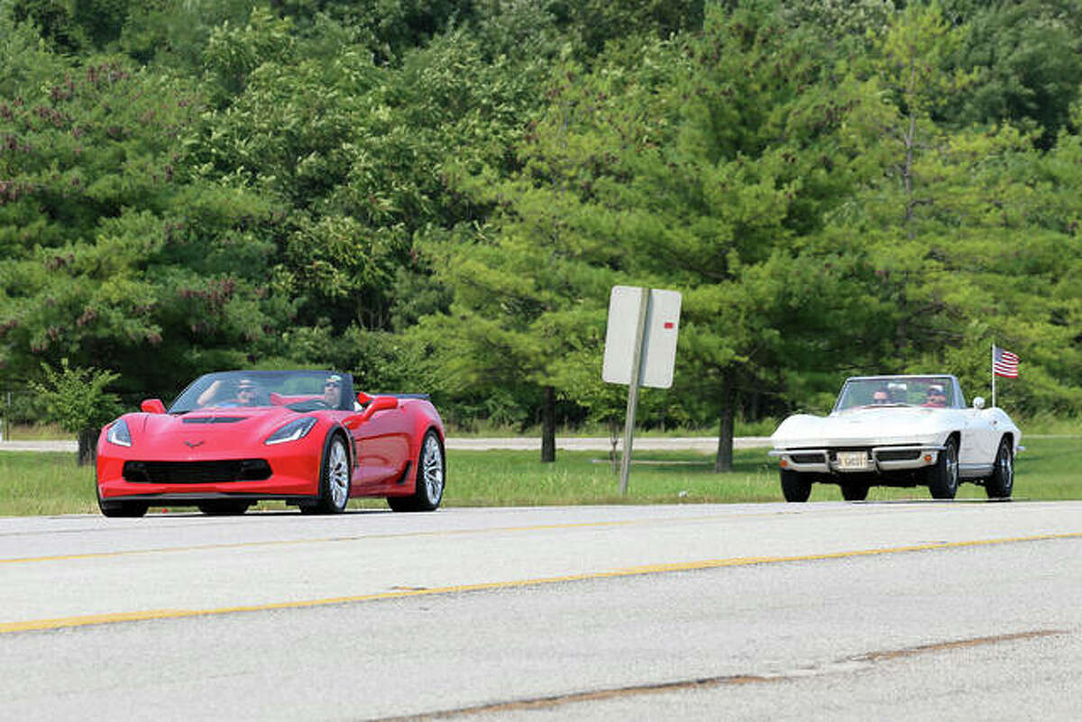 Participants crusing in the Kicks on Route 66 Ultra Car Show and Cruise in Edwardsville Saturday. In front is a seventh-generation Chevrolet Corvette droptop, circa 2014-2019, while behind it is a second-generation Corvette Covertible, 1963-1967.