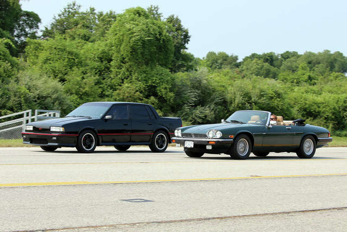Participants crusing in the Kicks on Route 66 Ultra Car Show and Cruise in Edwardsville Saturday. A Jaguar XJS Convertible paces at Chevrolet Celebrity Eurosport VR along Route 157.