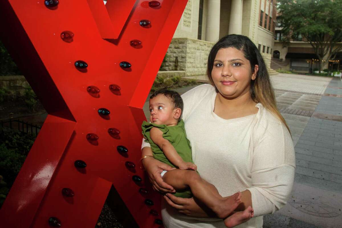 Fariha Dhanani with her daughter, Arya Shakir, at Sugar Land Town Center. Fariha was diagnosed with Graves' disease after having symptoms such as a high resting heart rate and uncontrollable shaking of her hands. she chalked it up to stress, owning a restaurant and being a chef. but once she was diagnosed with Graves' disease, she opted to have her thyroid removed. The traditional surgery leaves a scar on the neck, which Dhanani did not want. She found Dr. Raymon Grogan, who is able to remove the thyroid through the mouth. Within a week after her surgery, she was back to her regular routine. Now she is enjoying her life and her new baby daughter -- with no scar.