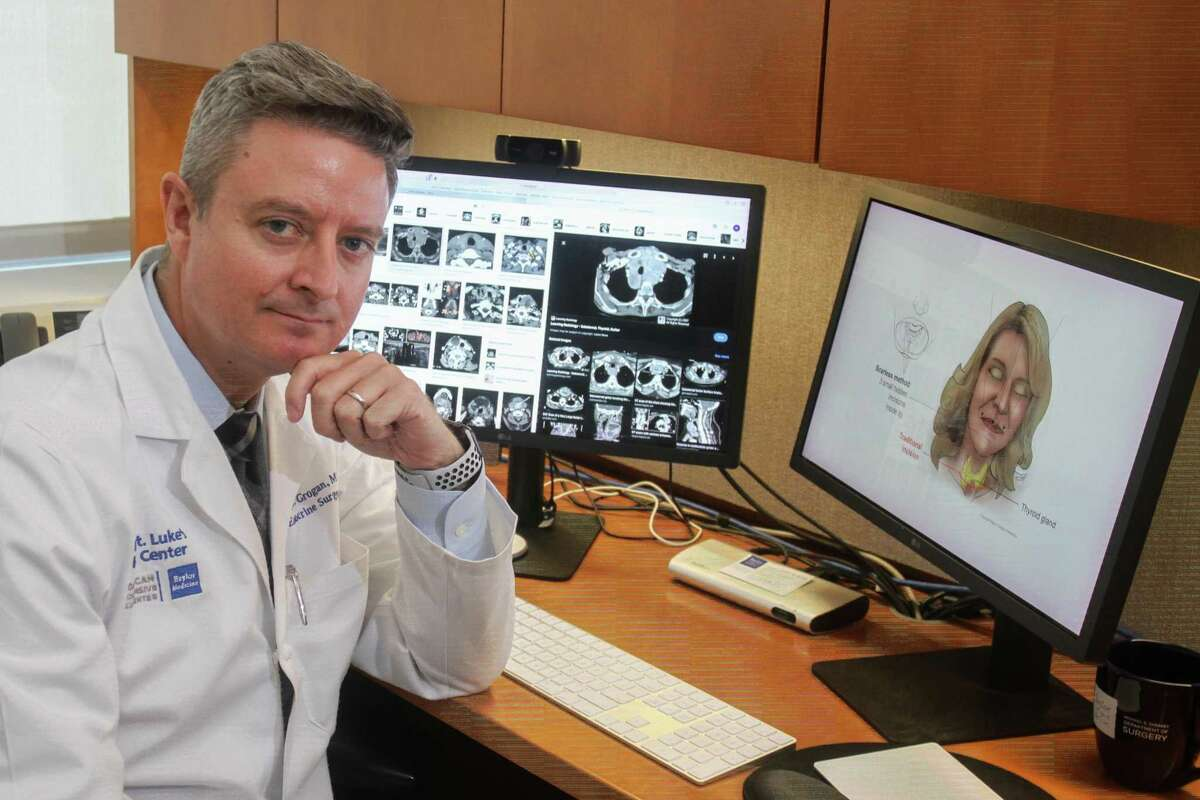 Dr. Raymon Grogan, associate professor of surgery at Baylor College of Medicine and section chief of endocrine surgery at Baylor St. Luke's Medical Center, reviewing images of the thyroid at Baylor's McNair Campus in Houston on August 16, 2021. Dr. Grogan is also with the Dan L Duncan Comprehensive Cancer Center at Baylor College of Medicine